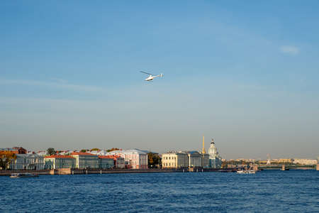 White helicopter over the blue river. Saint Petersburg 版權商用圖片
