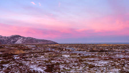 Panoramic view of old house against the Arctic sky. Old authentic village of Teriberka. Kola Peninsula. Russia.