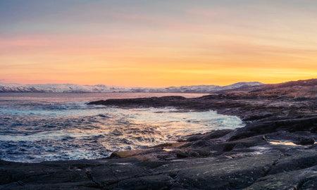 Arctic winter mountain hard-to-reach lakes. Northern wildlife. Panoramic view. Kola Peninsula. Teriberka.