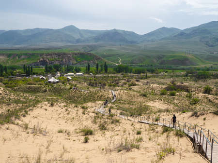 Scenic path to the Sarykum barkhan. Sand mountain in the Caucasus. Dagestan, Russia.