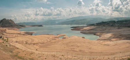 Beautiful futuristic views of the canyon and reservoir, travel concept. Cars on the beach. Remote view. Chirkeyskoe reservoir, Dagestan.