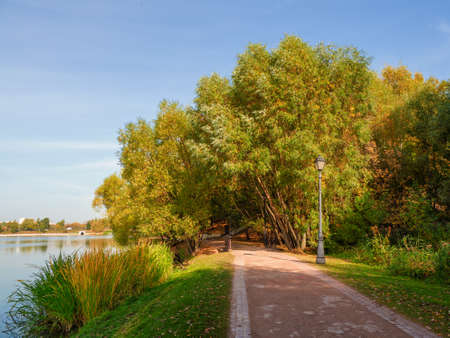 Panoramic view of Tsaritsyno autumn Park, with reflections of trees in the lake. Moscow Фото со стока