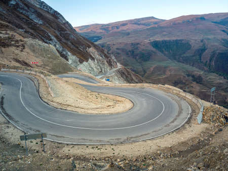 Dangerous narrow cliffside mountain road. Dangerous off road driving along mountain edge and steep cliff. Dagestan.