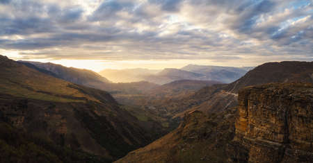 Soft focus. Golden sunset in mountain landscape. Silhouette of the evening mountains. Matlas. Dagestan. Panoramic view.