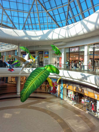 Russia, Saint Petersburg, June 17, 2021. Hanging ornaments in the style of nature in the shopping hall of the mall.