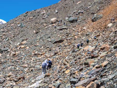 Group of hikers in the mountains. Treking group on their way to Aktru mountain. Altai. Siberia. Editorial