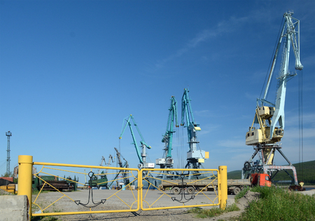 lena: port cranes on the river Lena, Lensk, Yakutia, Russia