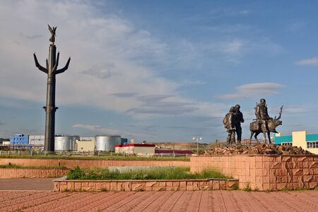 sculptural: Mirny, Russia - July 7, 2014: The memorial complex Vilyui ring. Bas Past, Present and Future diamond edge. Sculptural group Kayur and geologists. Stella Yakutia-mother.