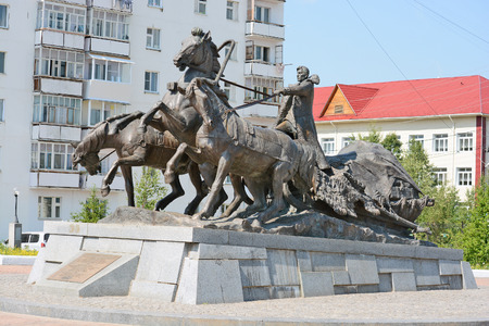 pioneers: Lensk, Russia - June 21,2014: a monument to the pioneers - the sculptural group from the coachman and horses in Lensk,  Sakha Republic, Russia. Editorial