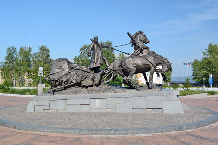 pioneers: Lensk, Russia - June 22,2014: a monument to the pioneers - the sculptural group from the coachman and horses in Lensk,  Sakha Republic, Russia.