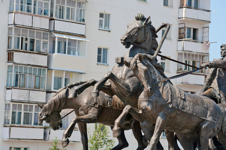 sculptural: Lensk, Russia - June 21,2014: a monument to the pioneers - the sculptural group from the coachman and horses in Lensk,  Sakha Republic, Russia. Editorial
