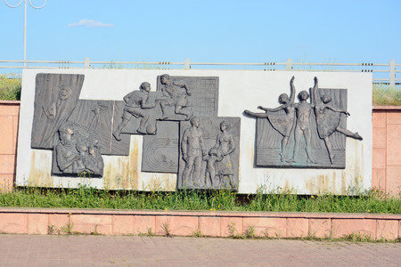 geologists: Mirny, Russia - July 7, 2014: The memorial complex Vilyui ring. Bas Past, Present and Future diamond edge. Sculptural group Kayur and geologists. Stella Yakutia-mother.