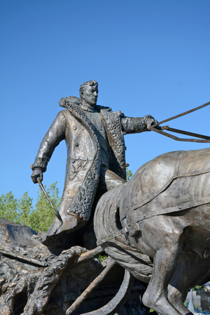 sculptural: Lensk, Russia - June 22,2014: a monument to the pioneers - the sculptural group from the coachman and horses in Lensk,  Sakha Republic, Russia.