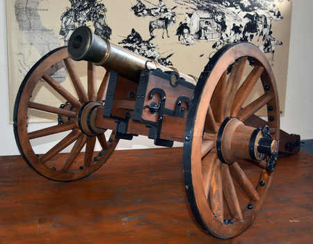 cannon gun: Novokuznetsk, Russia - October 18, 2014: 1-pound cannon on a gun carriage. A monument of history and architecture Kuznetsk fortress in the city of Novokuznetsk, Kemerovo region, Siberia Editorial