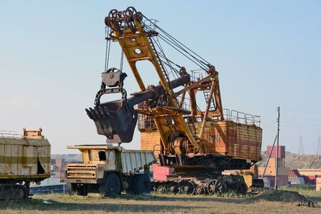 mining machinery: Mirny, Russia - July 16, 2014: Old mining machinery diamond career Mir in the town of Mirny, Yakutia
