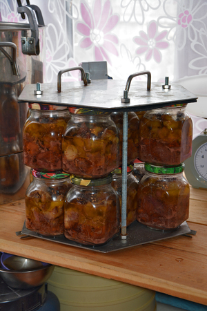 hermetic: glass jars of stew in the cassette after autoclaving