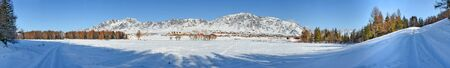 panoramic landscape of winter village road