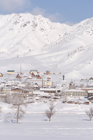habitable: Winter rural landscape in Siberia. The village in the Altai mountains.