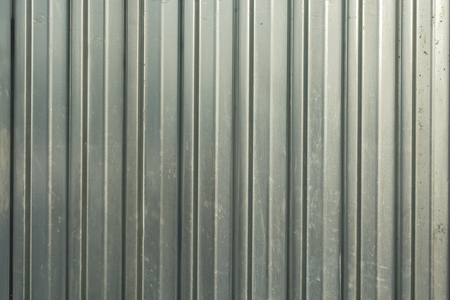 stainless: Corrugated iron of aluminum on a facade. Background image.