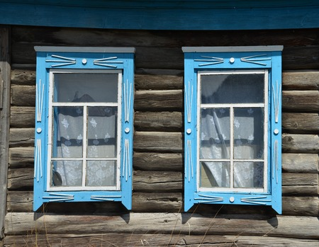 Two windows in the old wooden house