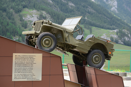 White Bom, Russia - July 11, 2017: Monument to drivers who died on the Chu tract, the car Willys MB. White Bom village, Altai Republic, Russia. Panorama big size.