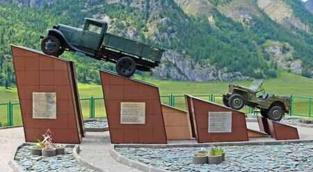 White Bom, Russia - July 11, 2017: Monument to drivers who died on the Chu tract, the first Soviet car AMO1. White Bom village, Altai Republic, Russia. Panorama big size.