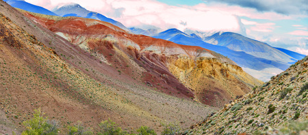 Outcrops of red rocks in the valley of the Kyzyl-chin stream. View on Altai mountain. Siberia, Russia. Panorama big size. Stock Photo