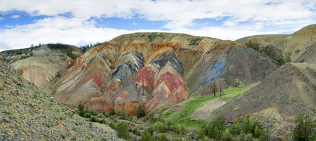 Outcrops of red rocks in the valley of the Kyzyl-chin stream. View on Altai mountain. Siberia, Russia Stock Photo