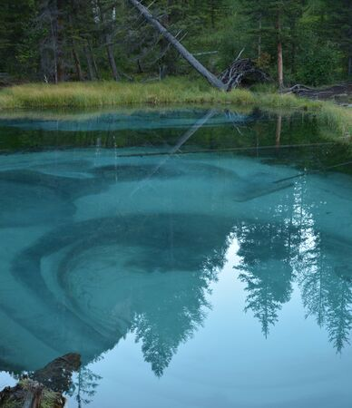blue geyser lake in Altay mountains. Siberia. Russia. Panorama big size.