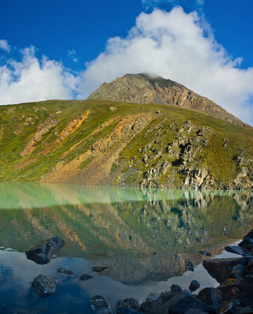 Beautifull turquoise lake mirror  with view to hill  in Altaj, Russia  at the summer Reklamní fotografie