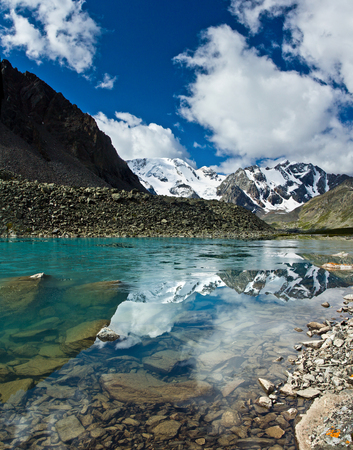 Beautifull turquoise lake with view to mountains in Altaj, Russia  at the summer