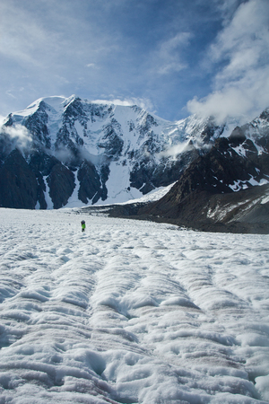 Climber in the snow mountains on the glacier in Altaj, Russia  at the winter in a sunny day