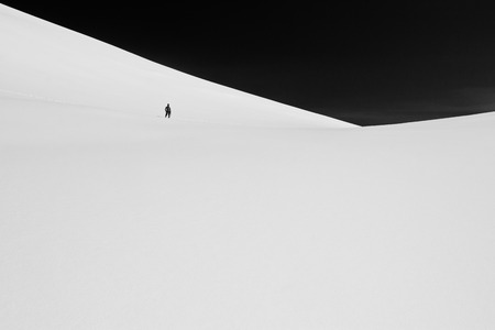 Climber in the snow mountains on the glacier in Altaj, Russia  at the winter, black and white photo