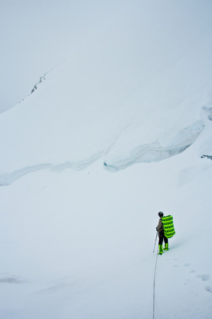 Climber in the snow mountains on the glacier in Altaj, Russia  at the winter