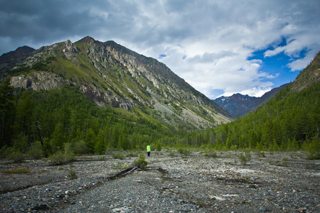 Beautifull  valley with view to mountains, forest and hiker in Altaj, Russia  at the summer