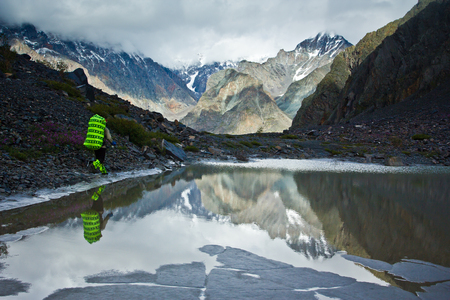 Beautifull valley with view to mountains and   lake with hiker in Altaj, Russia  at the summer Reklamní fotografie