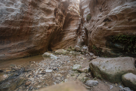 Misterious canyon Avakas with little stream and stones in the Cypros with sunlights