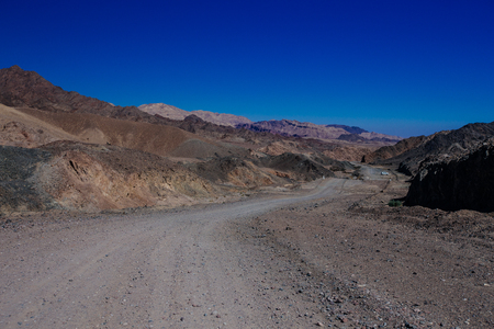 Way in the desert  in the Israil in sunny day with red mountains and blue sky near Eilat Reklamní fotografie