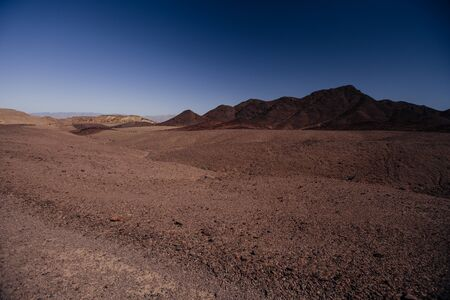 Way to Red canyon  in the Israil in sunny day with blue sky near Eilat with view to red mountains Reklamní fotografie