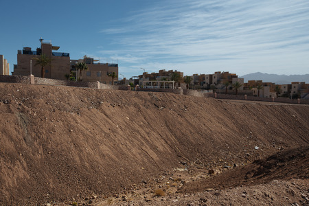 Suburb of Eilat city in the desert  in the Israil in sunny day with blue sky and rubish