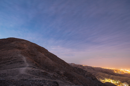 Way in the mountains near  of Eilat city in the desert  in the Israil in the evening sunset  with blue sky and city lights Reklamní fotografie