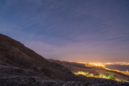 Suburb of Eilat city in the desert  in the Israil in the evening sunset  with blue sky and city lights Reklamní fotografie