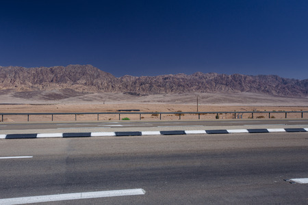 Road in the desert  in the Israil in sunny day with view to red iordan mountains and blue sky near Eilat Reklamní fotografie