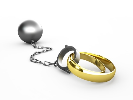 Wedding rings chained in shackles isolated in white photo