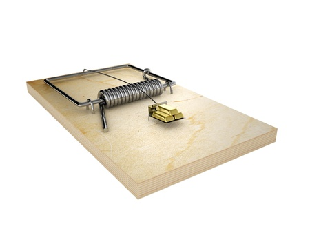 Mousetrap and gold ingots   Isolated on white background  photo