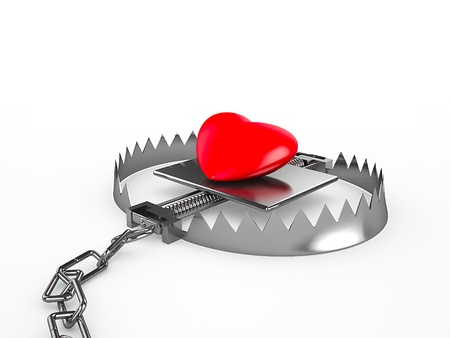 Red heart in a trap, isolated on white background Stock Photo - 18572405