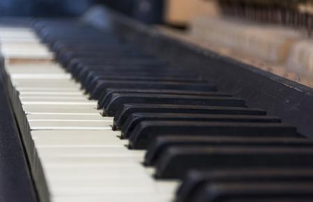 transcription: Ancient piano keys. Small depth of field.
