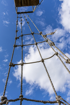rope ladder: Old rope ladder against cloudy sky