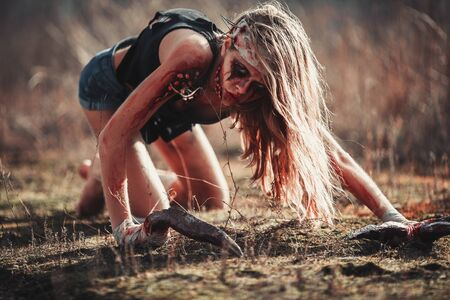 photomanipulation: Mutant humpback girl in wounds and ulcers with claws instead of fingers. She crawls on ground.