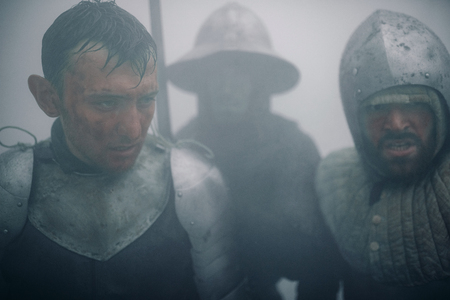 Portrait of medieval knights of the Crusaders in the misty morning. Stock Photo
